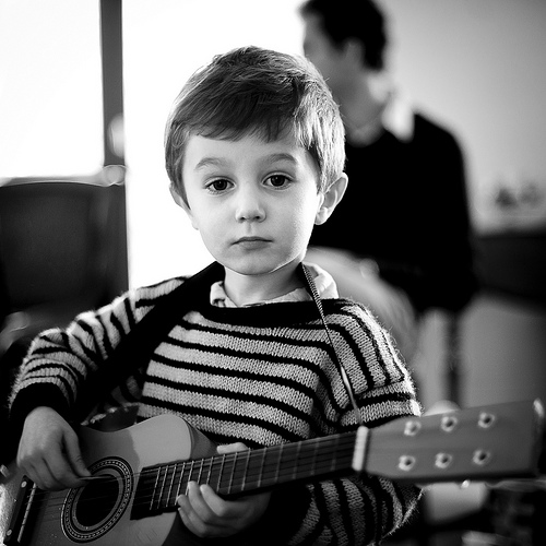 Child-Playing-Guitar